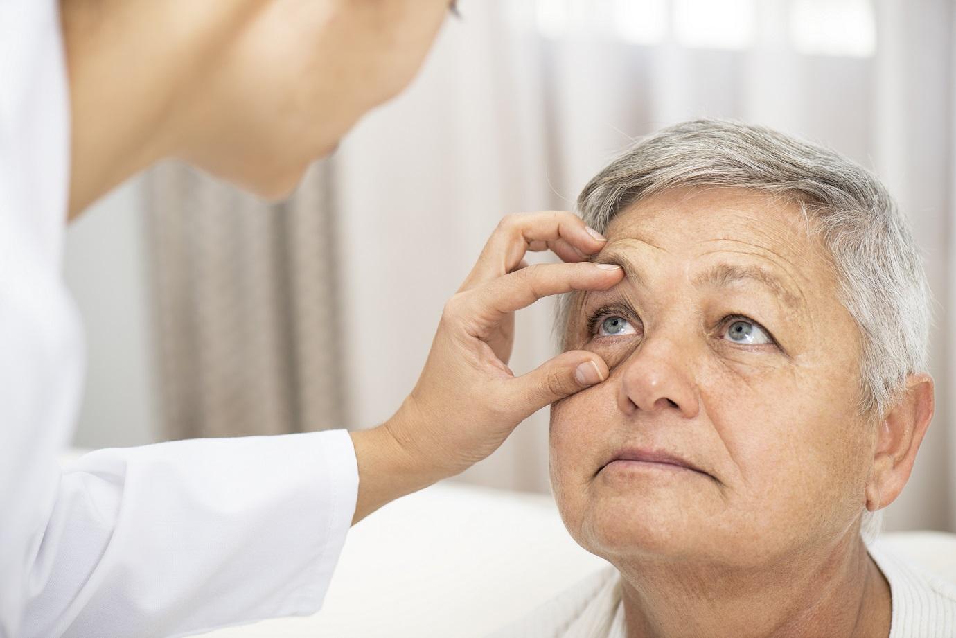 Doctor examining patient's eye.