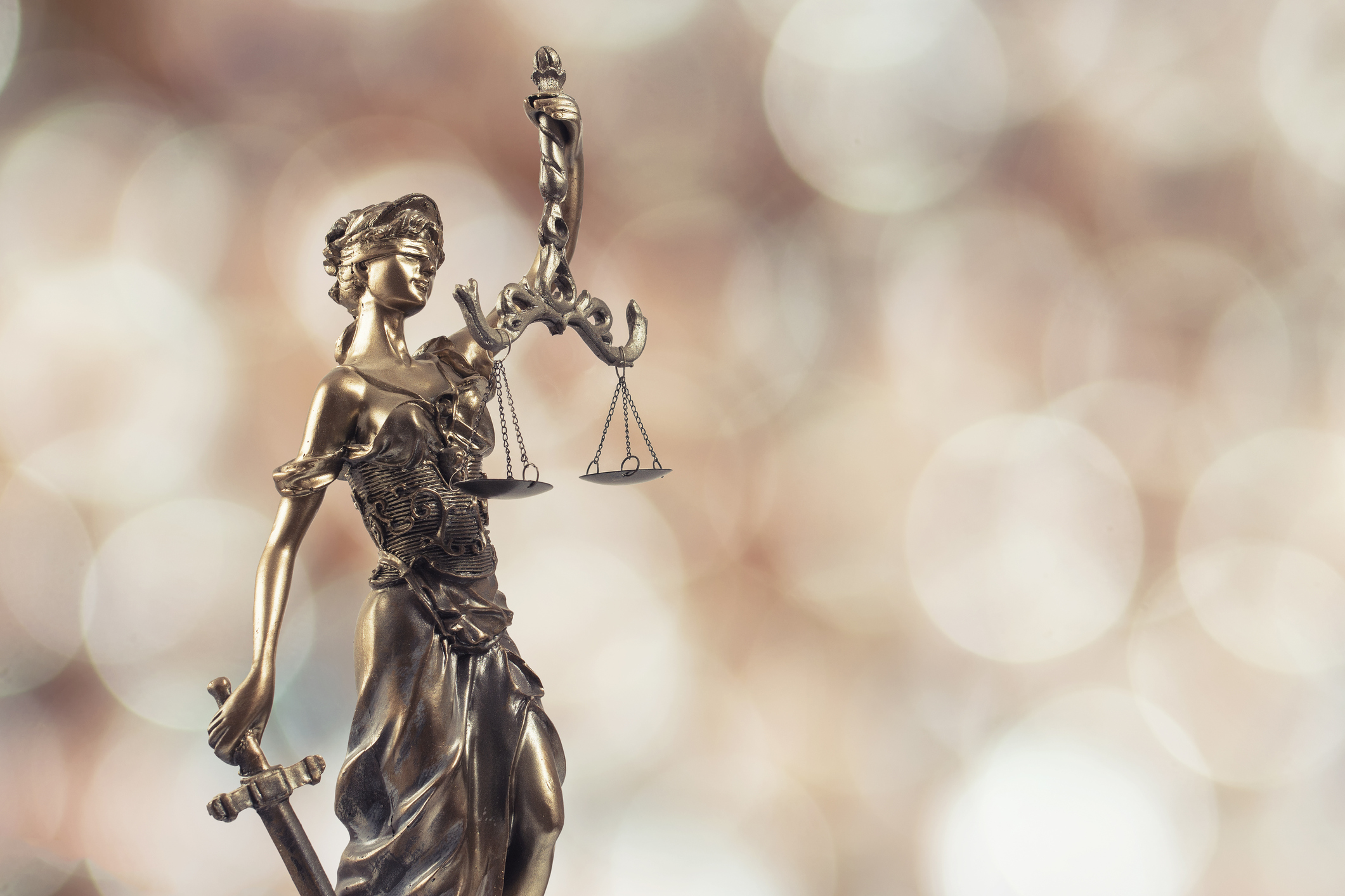 Statue of justice on Bokeh background