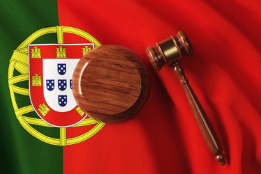 Gavel On Portuguese Flag: Portuguese Constitution and Justice Concept